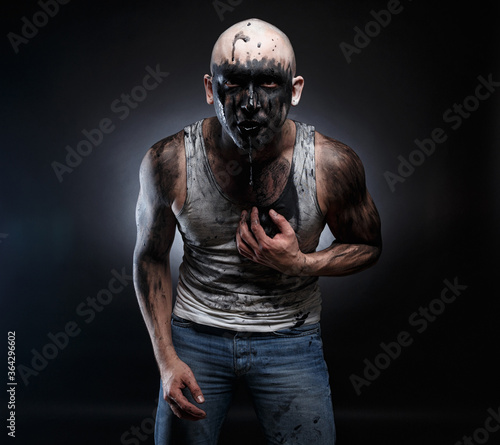 Photo Photo of bald mad man with black muck in the mouth