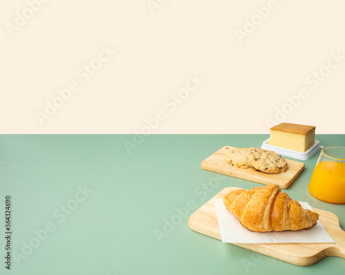 Photo Set of breakfast food or bakery,cake on table pastel color background