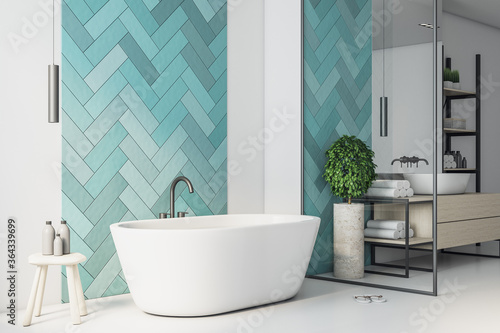 Clean turquoise bathroom with comfortable washbasin.