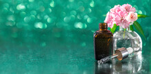 Bottles With Geranium Essential Oil And Fresh Geranium Flowers. Herbal Cosmetic Treatments. Nature Cosmetics Concept