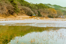 Partially Frozen Pond With Oriental Gazebo