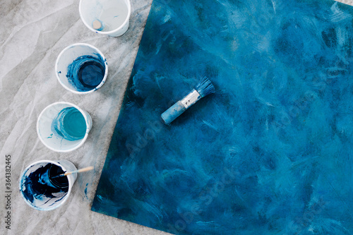 Fotografie, Tablou arts and craft hobbies concept, blue and black acrylic painting with colors in p