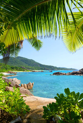Fototapeta Morze View on coast near Grand l'Anse beach in La Digue island, Indian Ocean, Seychelles. Tropical landscape with blue sunny sky.