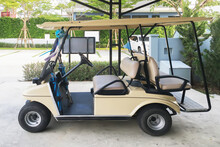 Golf Cart Electrical Car In Parking Garage Office Waiting For Transportation Service On Tropical Warm Holiday Season.