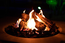 Warm And Cozy Evening At The Gas Fire Pit Table