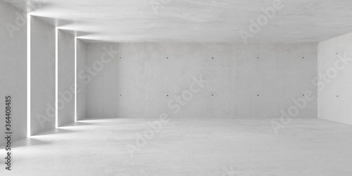 Fototapeta Abstract empty, modern concrete room with indirect lighting from side wall openings and rough floor - industrial interior background template obraz