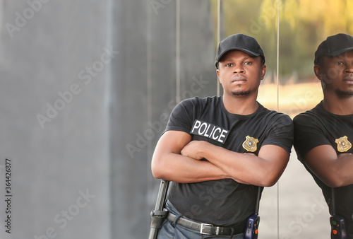 African-American police officer in the street Wallpaper Mural