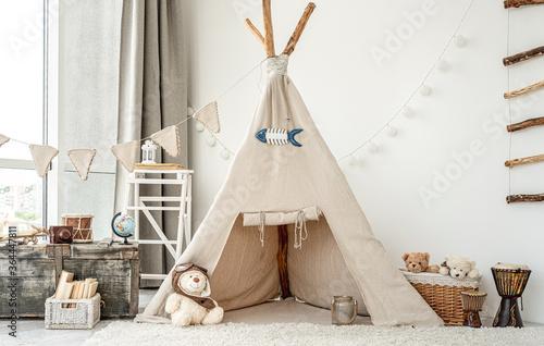 Photo Children's room interior with wigwam