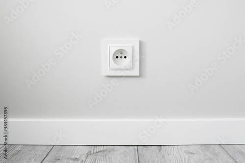 Fotografía New electrical socket isolated on gray wall