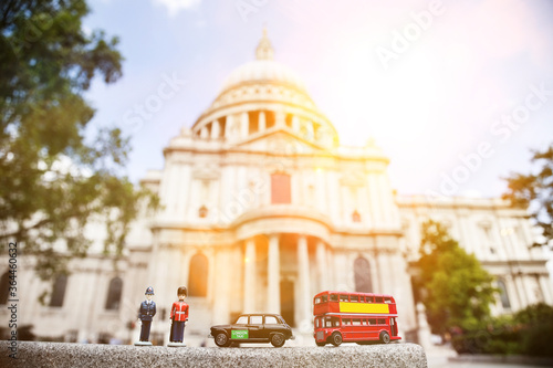 Figurines of London officers and public transports with St Canvas Print