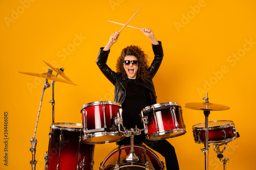 Photo of popular rocker redhair lady plays instruments beat raise hands drum sti Fototapeta