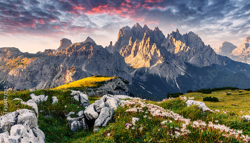 Fototapeta Amazing Dolomites Mountains Landscape with colorful sky. Panorama dramatic sunset in dolomites alp mountain from Tre cime di Lavaredo. Wonderful Alpine valley during sunrise. Scenic image obraz