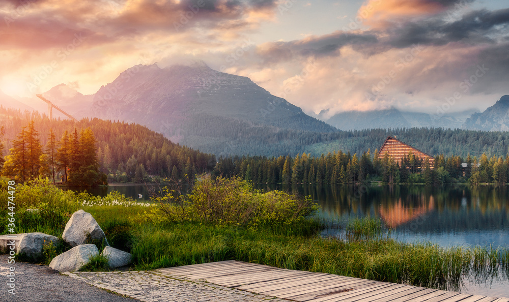Fototapeta Fabulous  view of Strbske Pleso during sunset, Slovakia. Dramatic, picturesque scene. Popular tourist attraction. Location place National Park High Tatra. Europe. Artistic picture. Amazing Landscape.