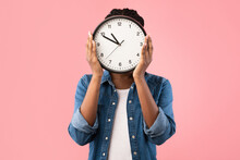 African Girl Holding Clock In ...