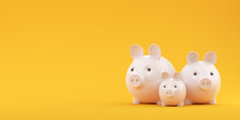 Three Piggy Banks On A Yellow ...