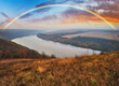 canvas print picture - colorful rainbow over river canyon