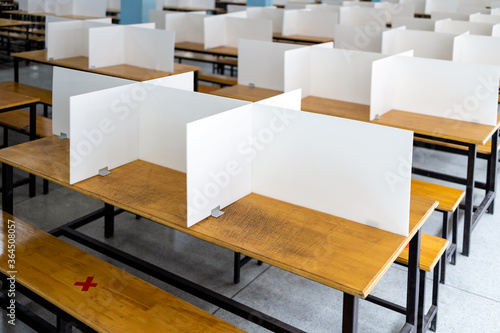 Corrugated plastic sheet partition on the tables in the cafeteria,food court at Fotobehang