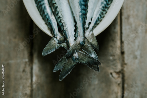 fish tails on a wooden table - 364509877