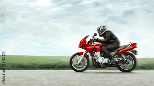Riding a sports bike at high speed on an empty road, in a circular field, in the Canvas Print