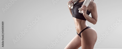 Obraz Beautiful fitness girl holding a towel - fototapety do salonu