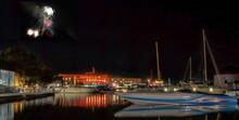 Powerboats And Sailboats At Night Under Fireworks In Kingston Marina Nobody