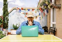 Thoughtful Elderly Male In Cap...