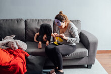 Young Mother Sitting On Sofa I...