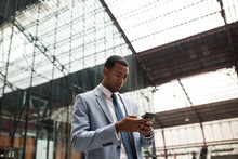 Trendy Black Businessman Using Phone