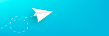 Paper Plane On A Blue Horizontal Background Copy Space.