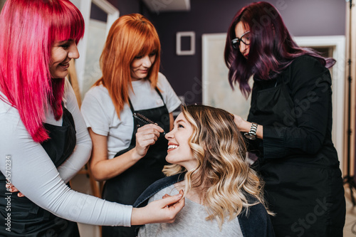 Beautiful hairstyle of young woman after dyeing hair and making highlights in hair salon Fototapet