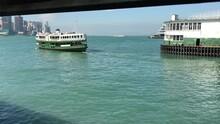 Hong Kong, China, A Large Ship In A Body Of Water