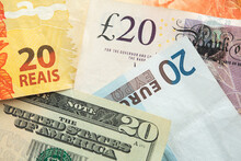 Banknotes, Pound Sterling, Dollar, Real And Euro, Closeup