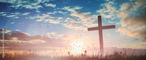 Silhouette jesus christ crucifix on cross on calvary sunset background concept for good friday he is risen in easter day, good friday worship in God, Christian praying in holy spirit religious Fototapet