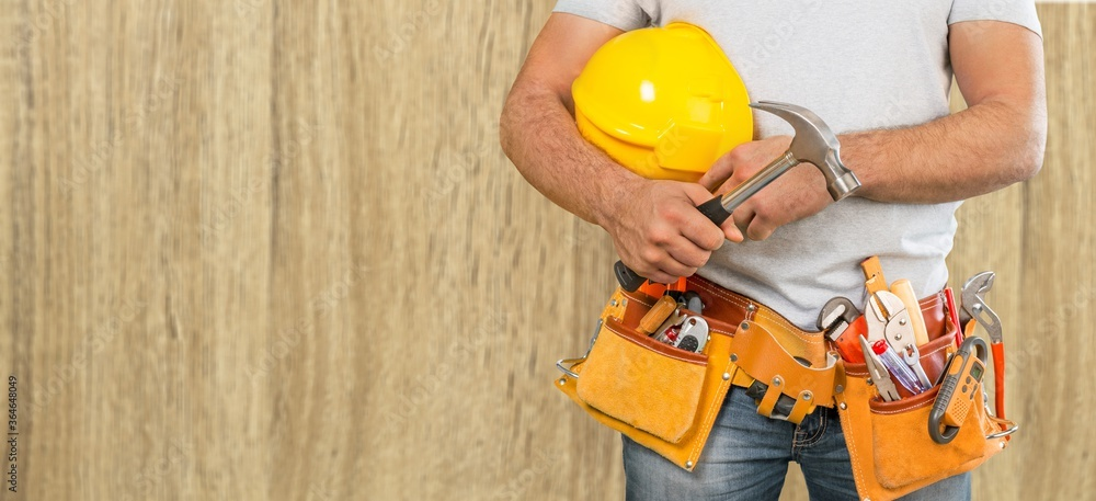 Fototapeta Man worker or professional builder with tools