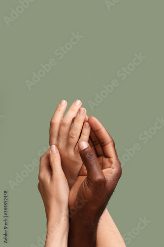Hands of Caucasian woman and African-American man on color background. Racism concept - 364652458