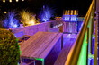 Gas barbecue on a stylish illuminated wooden terrace