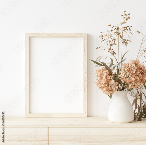 Fotografiet Mock up frame in home interior background, white room with natural wooden furnit