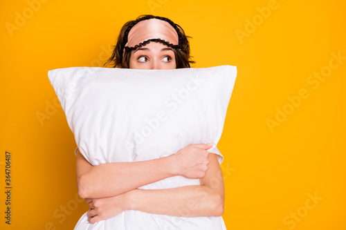 Obraz Portrait of shocked terrified girl see nightmare embrace her soft pillow look copyspace wear pajama eye mask isolated over bright shine color background - fototapety do salonu