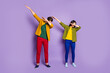 canvas print picture - Full body photo lady guy students two people couple dance modern strange youth moves dab step motion wear casual green yellow shirts trousers shoes isolated purple color background