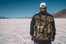 Back View Of Male Traveler Wit...