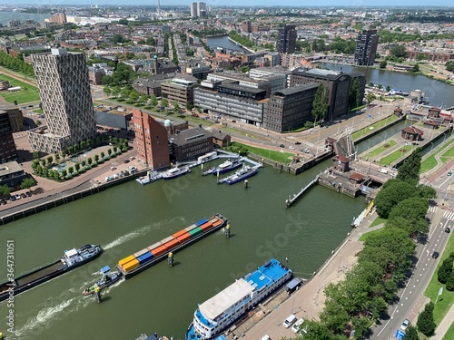Cargo ship is going in the New Meuse (the Nieuwe Maas) river locks Fototapeta