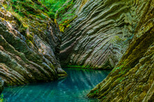 Rocky Gorge With Green Musk An...