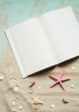 Summer Template. Travel Planning. Notepad, Small Seashells, Starfish On Sand. Place For Text On Blank White Notepad Pages.