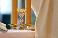 Chalice On The Altar And Pries...