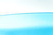 Blue water surface on a white background with spaces for text.