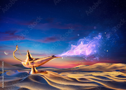 Photo Wish Lamp On The Sand In Desert With Genie