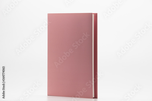 Fotografie, Tablou Pink Hardback Book With Copy Space Isolated on White Background