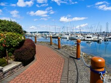 Tranquil Walkway Around Marina With Moored Yachts In Sidney On Vancouver Island, British Columbia, Canada