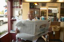 Senior Man Sitting In Barber's...