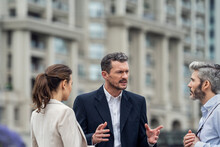 Businesspeople Talking In City